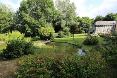 A acheter ensemble immobilier à colombages de 255 m² avec rivière et étang en Normandie